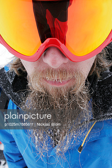 Extreme close-up portrait of a bearded skier in goggles nature Nicklas Blom one person outdoor outsi