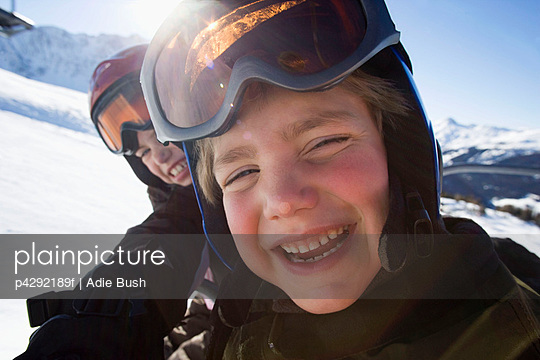 Children in ski helmets and goggles