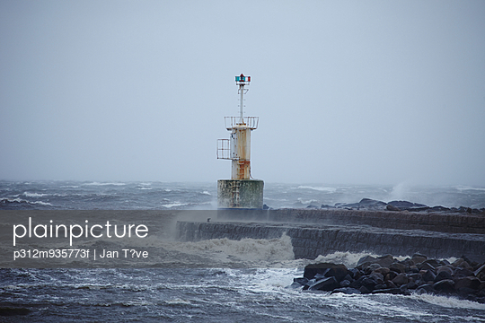 Lighthouse at stormy weather