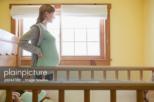 Expectant mother by crib
