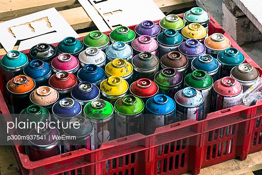 Plastic box of aerosol cans of spray paint