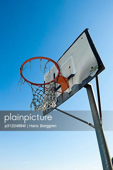 An old basket goal against the sky, Sweden.
