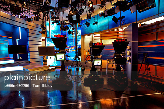 Television Studio With Lighting, Camera, Monitors And Backgrounds
