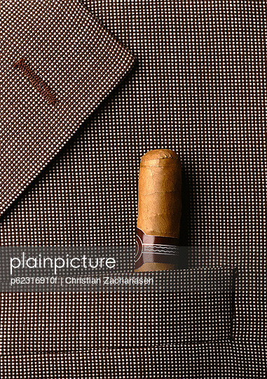 Man\'s jacket lapel with cigar in pocket