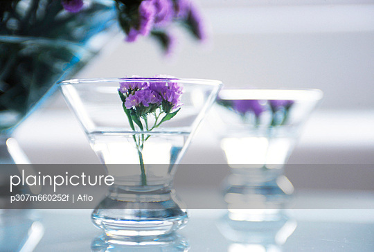 Purple Flowers In Glass Bowls
