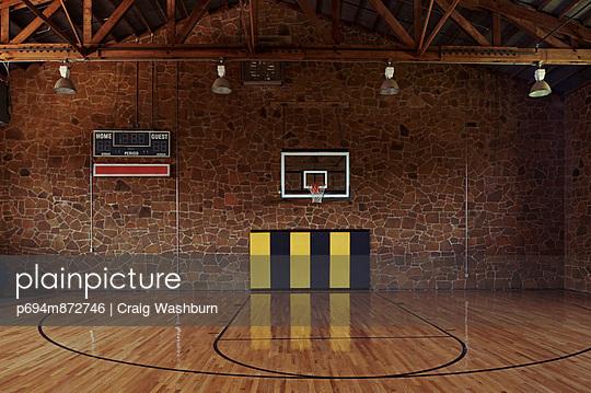 Basketball Gymnasium with Stone Wall
