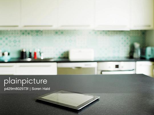 Digital tablet on kitchen counter
