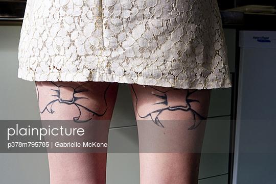 Tattooed bows on legs