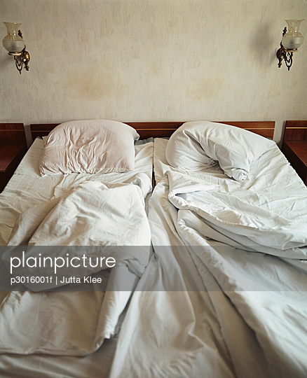 Unmade bed in hotel room