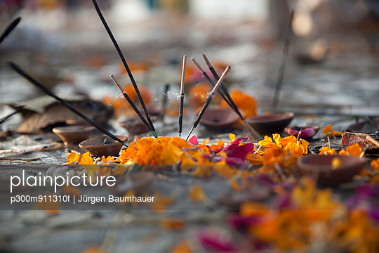 India, Uttar Pradesh, Allahabad, Kumbh Mela pilgrimage, Joss sticks and petals