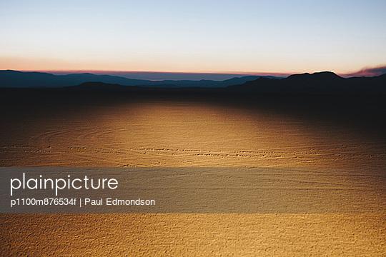 Illuminated desert landscape, dusk