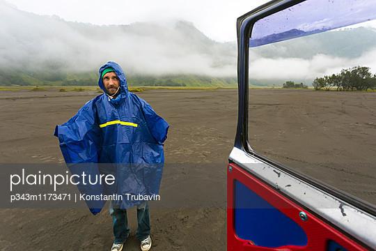 Man in rain coat with volcanic dust,Bromo,Java,Indonesia