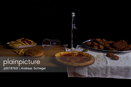Variety of fast food and beer bottle, still life