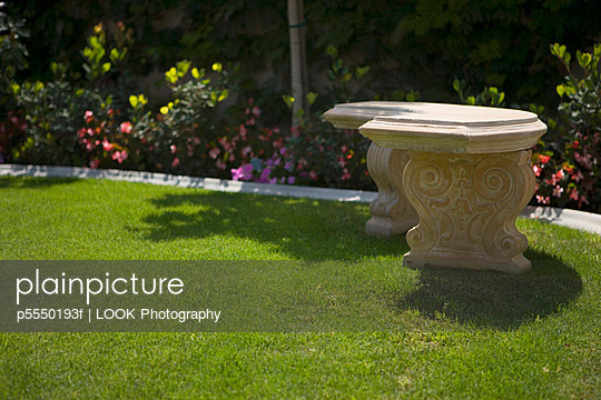 Stone Bench in Yard with Garden