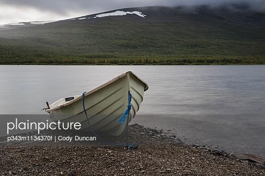 Row boat on shore of lake Teusajaure outside Teuesjaure hut, Kungsleden trail, Lapland, Sweden