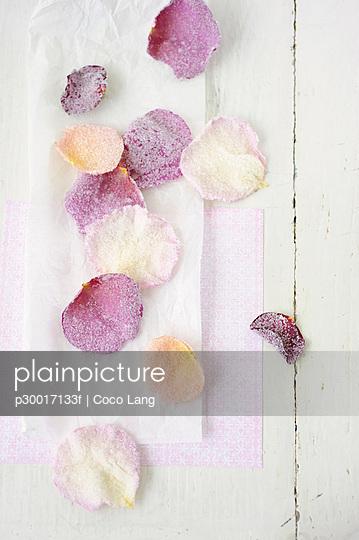 Sugared rose petals on wax paper, close up