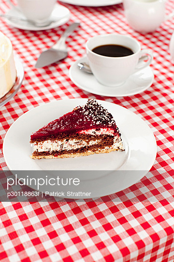 A slice of cake and cup of coffee