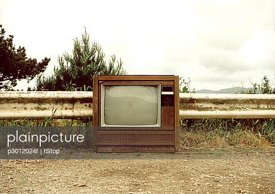Television on a dirt path
