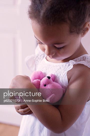 Little girl holding teddy bear