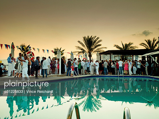 People having party by swimming pool