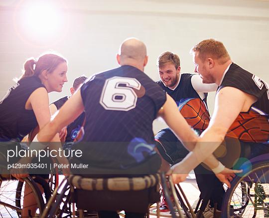 Wheelchair basketball players display team encouragement