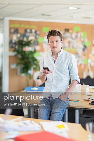 Young man in creative office