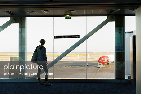 France, Provence-Alpes-Cote d´Azur, Woman looking though window at airport runway