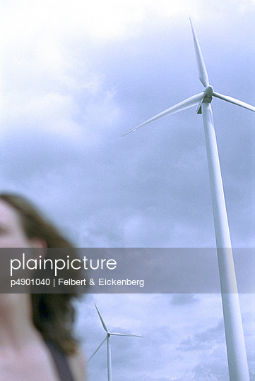 Woman (cropped, blurred) and Wind Turbines