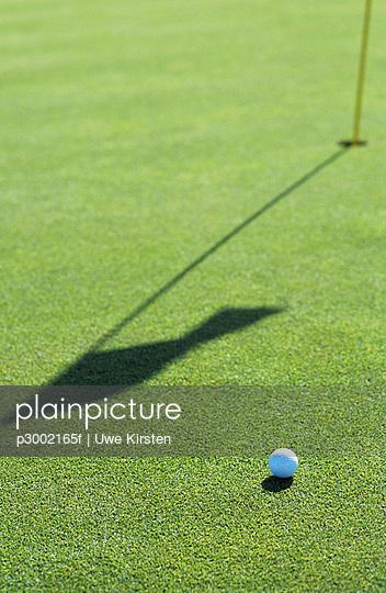 Golf ball on golf course; close-up