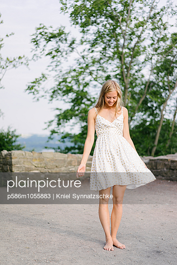 Woman in white summer dress