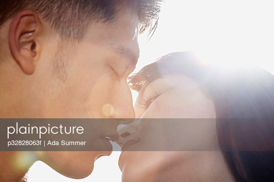 Couple kissing in sunshine
