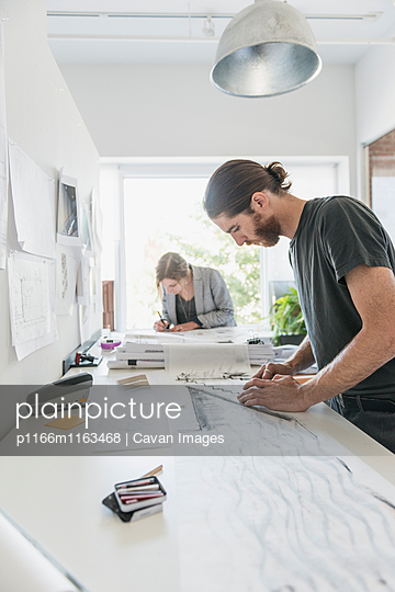 Artists making sketches in office