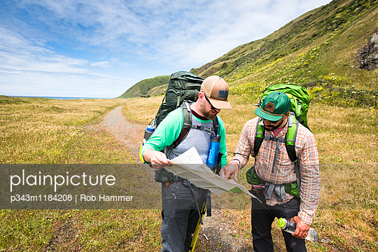 Two backpackers reading a map