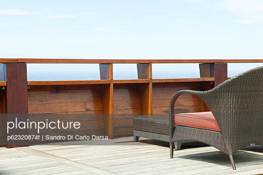 Wicker patio furniture on deck