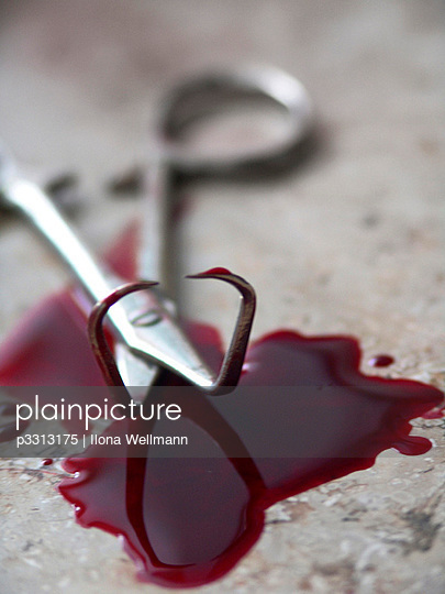 Surgical scissors in a pool of blood