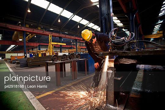 Welder at work in shipyard