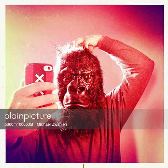 Gorilla selfie scratching head