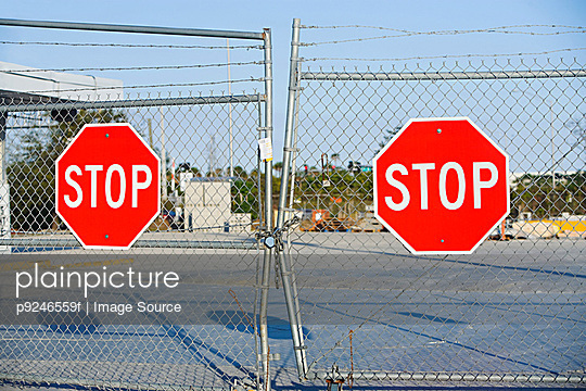 Stop signs on gates