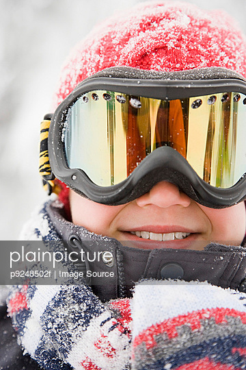 Boy wearing ski goggles