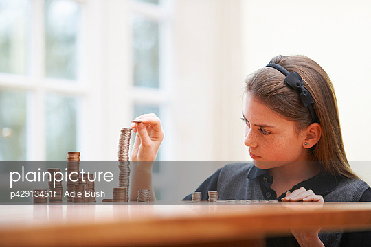 Girl Counting money at a table