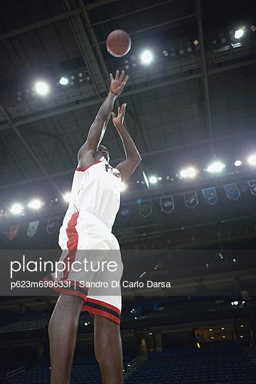 Basketball player shooting basketball