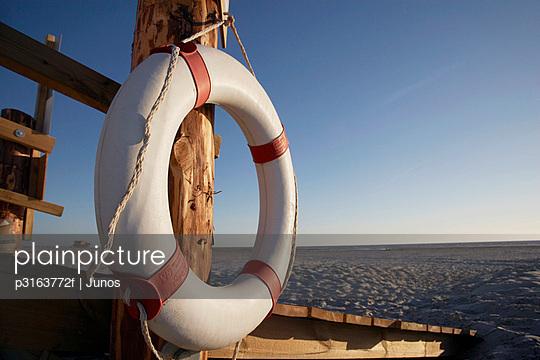 still life of life buoy on beach