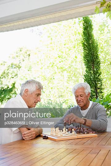 Pair of senior men playing chess
