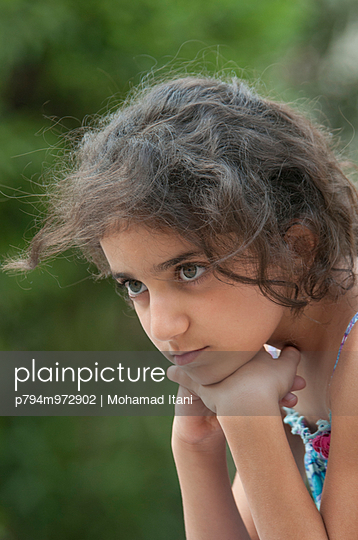 Beautiful little girl looking away