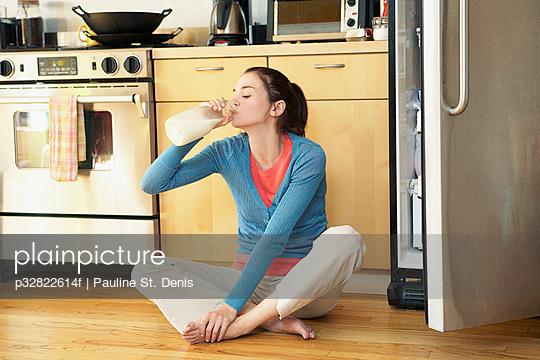 Woman drinking milk from bottle