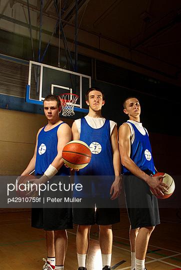 Three basketball players together