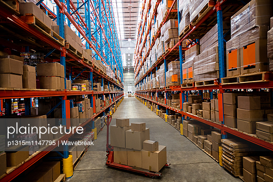 High angle view of warehouse aisle with no people