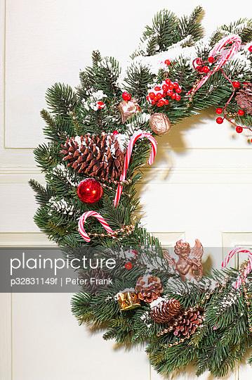 Christmas wreath hanging on a door