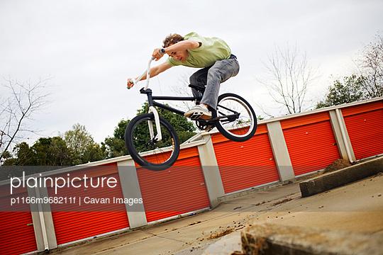 BMX biker jumping off a ledge