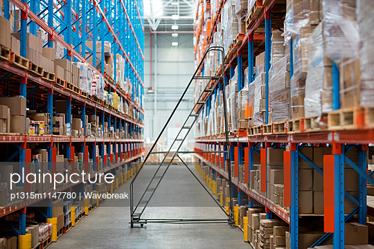 Front view of empty aisle in warehouse